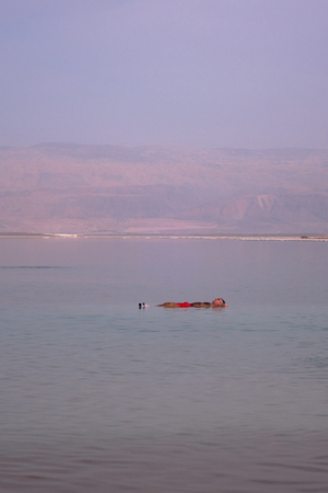 Man floating on the Dead Sea - Israel Stock Photo