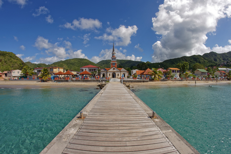 Les Anses dArlet - Martinique FWI - View to the city and the church from the pier 写真素材