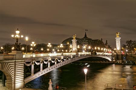Night view of Alexandre III bridge on the Seine - Paris, France