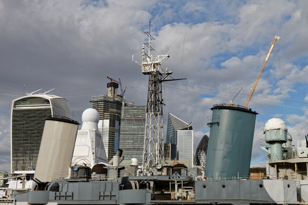 View to the city through chimney of a military boat - London, UK Imagens