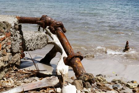 les Trois-Ilets, Martinique, FWI - Rusted pipe of an old house destroyed by the sea