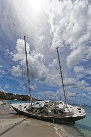 Sainte-Anne, Martinique, FWI - Abandoned beached sailboat in Pointe Marin beach Stock fotó