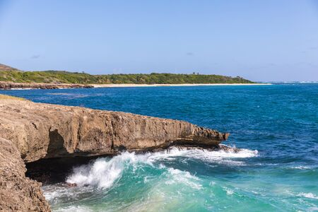Sainte-Anne, Martinique, FWI - Ferre Cape - Waves on the rocks in Pointe La Rose - Anse Baleine beach in the background