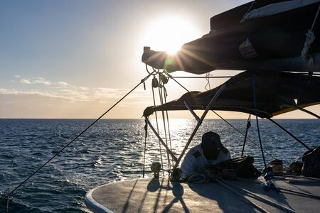 Saint Lucia, West Indies - Skipper of a sailing yacht at the sunset Stockfoto