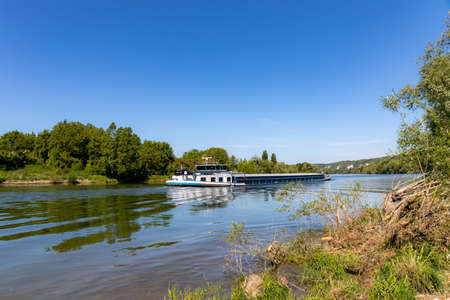 Barge moving on Seine River near Giverny, France