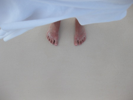 A photo of two feet in the water Stock Photo