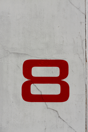 A photo of a number eight on a wall