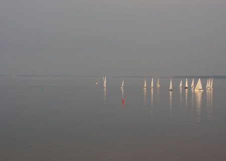 A photo of sailing boats on a lake