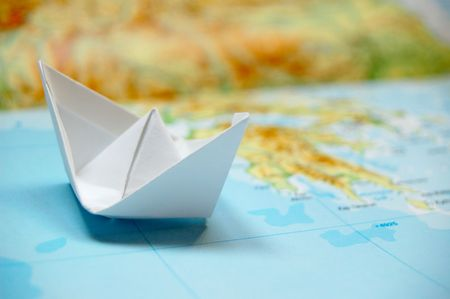 paper boat on a map, holiday dream Stock Photo