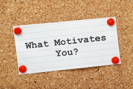 What Motivates You The question typed onto a piece of lined paper pinned to a cork notice board  Stock Photo