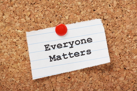 matters: The phrase Everyone Matters typed onto a scrap of lined paper and pinned to a cork notice board