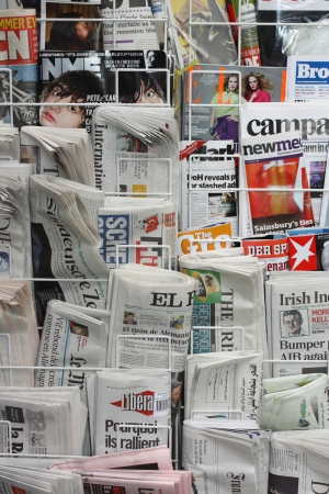 London, England, May 14, 2011 - English and international newspapers and magazines on display in a rack Editorial