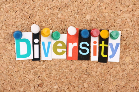 The word Diversity in cut out magazine letters pinned to a cork notice board Stock Photo