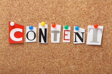 content writing: The word Content in cut out magazine letters pinned to a cork notice board  Content is an important part of marketing and search engine optimization for web content and advertising