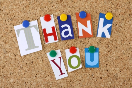 appreciation: The words Thank You in cut out magazine letters pinned to a cork notice board Stock Photo