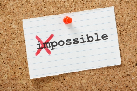 The word Impossible changed to possible by crossing out the first part of the word
