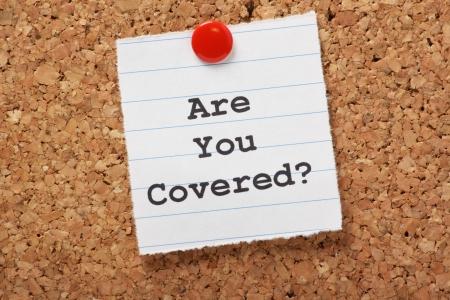 insurance concepts: The words Are You Covered  typed on a scrap of lined paper and pinned to a cork notice board  Asking the question, are you insured for your car, travel, home or other liability  Stock Photo