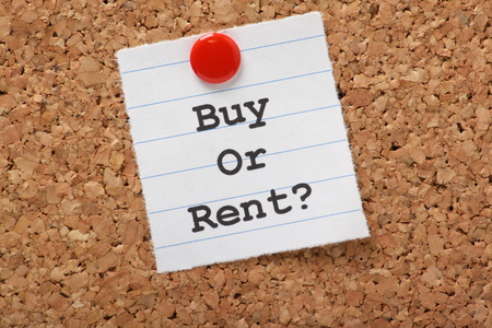 buying questions: The question to Buy or Rent  typed on a scrap of lined paper and pinned to a cork notice board  A decision aided by analysis of the real estate market and our personal finances  Stock Photo
