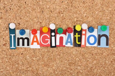 imagination: The word Imagination in magazine letters pinned to a cork notice board