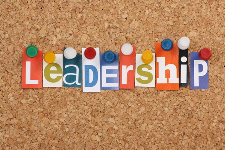 notice of: The word Leadership in cut out magazine letters pinned to a cork notice board