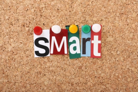 achievable: The word Smart in cut out magazine letters pinned to a cork notice board, representing the business concept of Smart Goals, Specific,Measurable ,Achievable,Realist ic and Timely