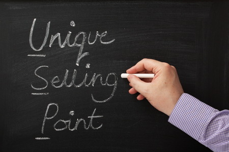 jargon: Hand writing the words Unique Selling Point on a blackboard  The USP of your business plan is a key to success and competitive advantage in the market place