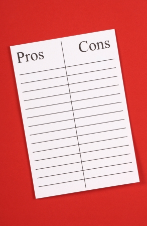 pro: A blank list of Pros an Cons on lined paper against a red textured paper background  Such lists help assess opportunity or current situations and relationships and make your decision  Stock Photo