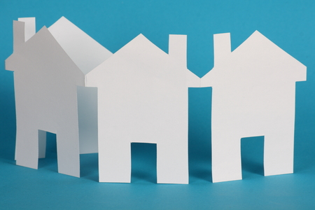 A paper chain in the shape of houses using blank white paper for copy space, as a concept for buying property and the property market photo
