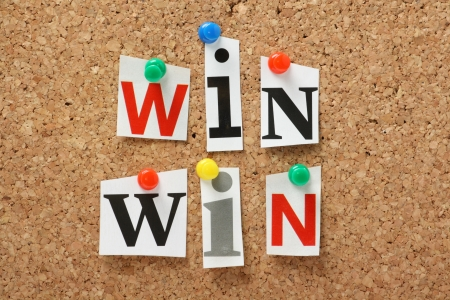 outcomes: The phrase Win Win in cut out magazine letters pinned to a cork notice board  In any transaction or undertaking we look for mutual benefits and positive outcomes for all parties