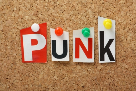 Punk, the word for a genre of modern music and fashion style in cut out magazine letters pinned to a cork notice board photo