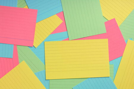 prompt: Several lined note or prompt cards in various colors