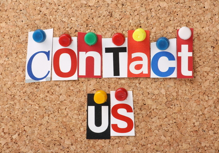 contact us: The words Contact Us in cut out magazine letters pinned to a cork notice board
