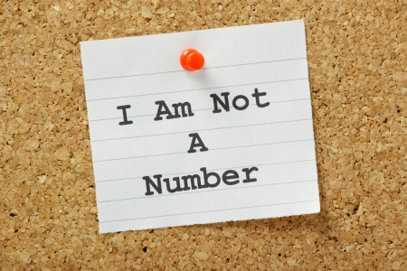 The phrase I Am Not A Number typed onto a piece of paper and pinned to a cork notice board  A concept for being treated with respect as an individual person  Stock Photo