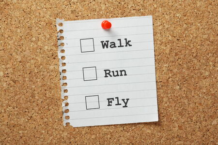 Tick Boxes with the choices to Walk, Run or Fly as a concept for making progress towards your goals Stock Photo - 25793707