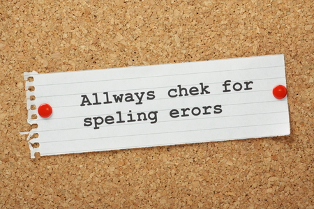 errors: The phrase Always Check For Spelling Errors on a cork notice board