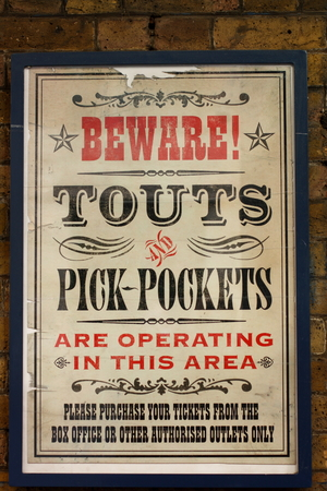 warns: LONDON, ENGLAND - OCT 23  A vintage poster on the outer wall of the Theatre Royal warns patrons to beware of touts and pick-pockets on October 23 2009  In 2012, London theatres grossed sales of 530M