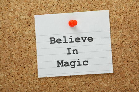 open minded: The phrase Believe in Magic typed on a piece of paper pinned to a cork notice board