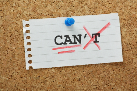 The word Can t changed to Can and underlined on a piece of lined paper pinned to a cork notice board