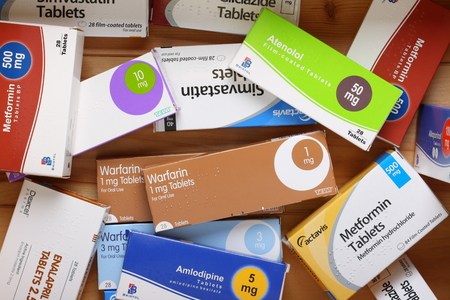 metformin: Bracknell, England - February 10, 2014  A wooden drawer full of drug boxes for medication including Warfarin, Metformin, Simvestatin and Amlodipine, from various manufacturers