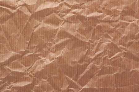 scrunched: A textured background made from crumpled brown wrapping or parcel paper Stock Photo