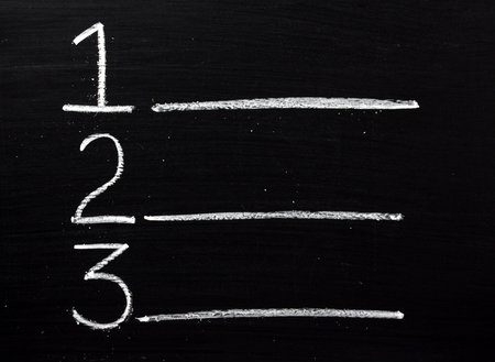 Choices or places of one,two or three written on a blackboard with copy space