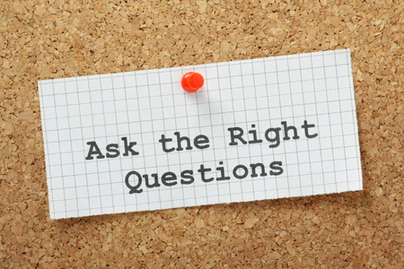 Ask The Right Questions typed on a piece of graph paper and pinned to a cork notice boards  This is essential to make an impression at interviews or obtain useful and relevant information