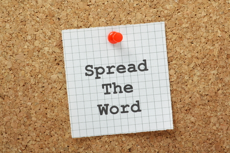 spread the word: Spread the Word typed on a piece of graph paper and pinned to a cork notice board