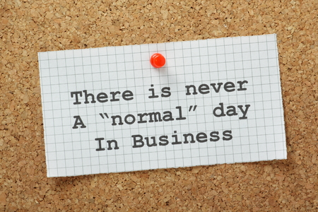 nimble: There is never a normal day in business typed on a piece of graph paper pinned to a cork notice board  A concept for understanding change and the challenges faced by any business enterprise