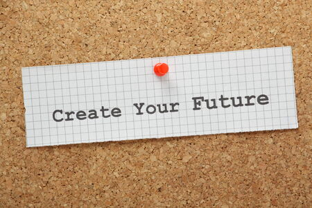 foresight: The phrase Create Your Future typed on a piece of graph paper and pinned to a cork notice board