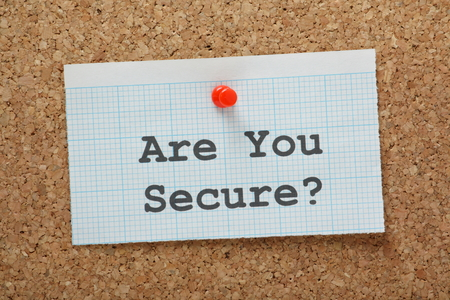 theft prevention: The phrase Are You Secure  typed on a piece of graph paper and pinned to a cork notice board Stock Photo