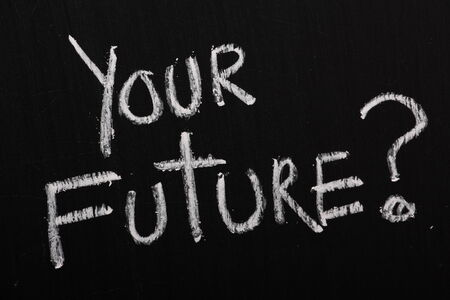 The phrase Your Future with a question mark written in white chalk on a blackboard photo