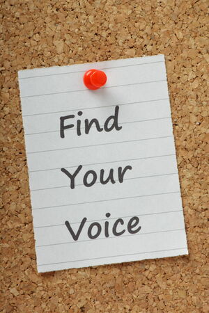 personal contribution: The phrase Find Your Voice typed on a piece of paper and pinned to a cork notice board  Stock Photo