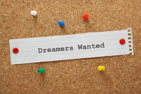 thinkers: The phrase Dreamers Wanted typed on a piece of paper and pinned to a cork notice board Stock Photo