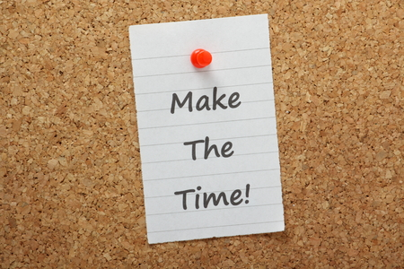 The phrase Make The Time typed on a piece of paper and pinned to a cork notice board  A concept for Time Management and getting your priorities in order photo